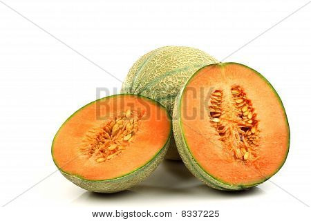 One whole cantaloupe melon and two halves