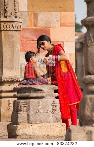 Delhi, India - November 4: Unidentified Woman Gives Water To Unidentified Child In Quwwat-ul-islam M