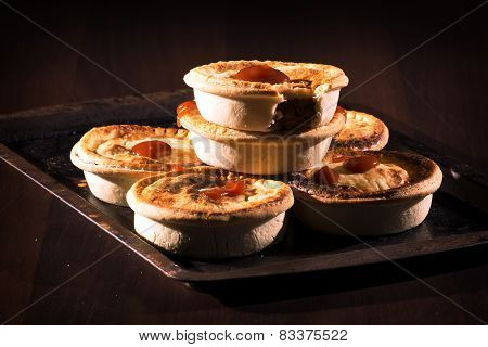 Meat Pies with sauce and high contrast lighting.