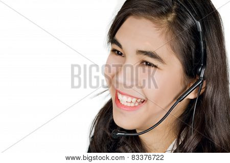 Smiling young woman on head set, customer service