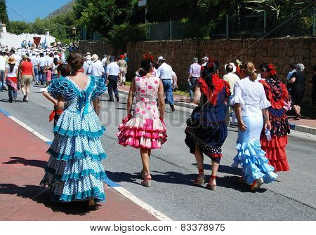 Spanish women in flamenco dresses.