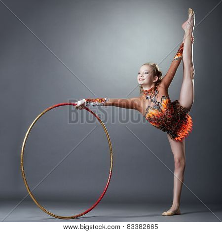 Adorable rhythmic gymnast doing vertical split