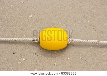 Yellow Bouy at the  beach