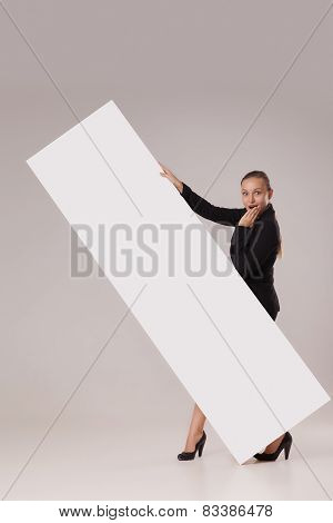 Happy woman behind blank copy space banner