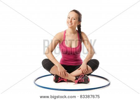 beauty girl sitting with hula hoop on floor