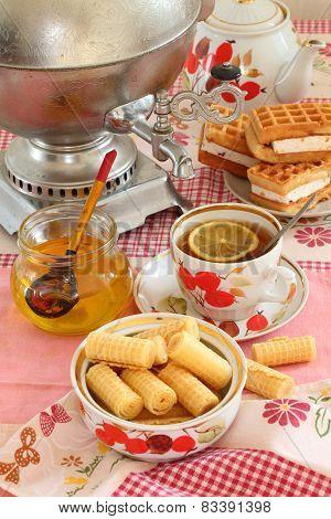 Tea From A Samovar, With A Lemon, Honey, Cakes And Wafers