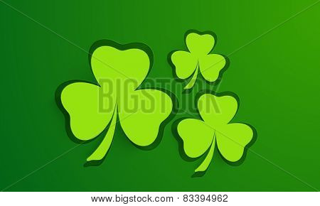 Shiny green shamrock leaves background for St. Patrick's Day celebrations.