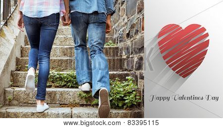 Hip young couple walking up steps against cute valentines message