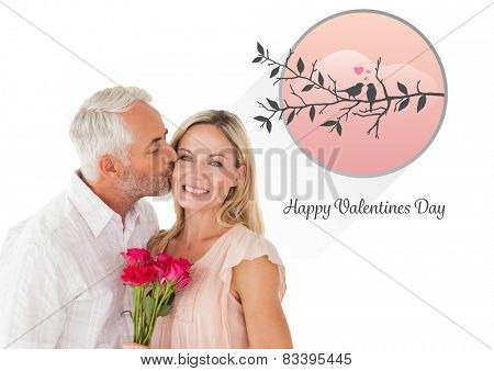 Affectionate man kissing his wife on the cheek with roses against cute valentines message