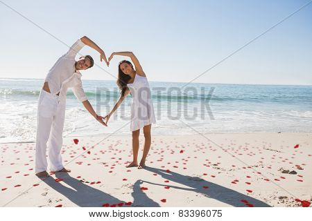 Loving couple forming heart shape with arms against red love hearts