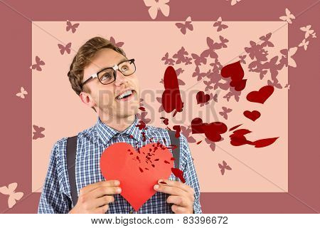 Geeky hipster holding a heart card against stencil butterfly pattern design in pink tones