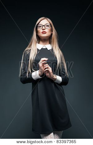 portrait of blonde woman wearing glasses