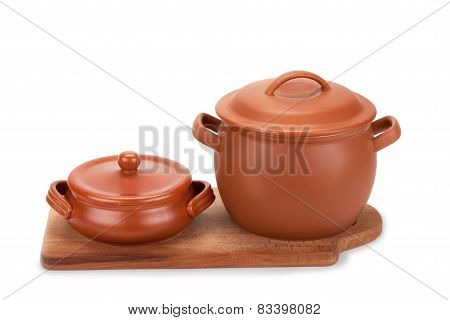 Clay Pots And Cutting Board