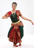 image of bharatanatyam  - Woman performing bharatanatyam dance in rich religious dress - JPG