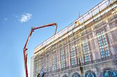 picture of concrete pouring  - Concrete pouring during commercial concreting floors of buildings in construction - JPG