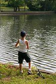 Boy Fishing During Summer poster