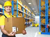 image of young men  - manual worker with parcel and warehouse parcel - JPG