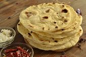 foto of pita  - Freshly baked pita bread on a wooden table - JPG