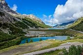 pic of lagos  - Lago di Fedaia in the Dolomites mountains of northern Italy - JPG