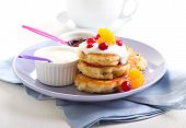 stock photo of buttermilk  - Buttermilk muesli pancakes with fruits and berries - JPG