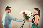 stock photo of lovers  - Lover boy gives flowers to his girlfriend - JPG