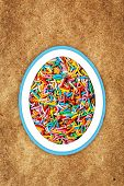 foto of sprinkling  - Colorful easter background with different sweet sprinkling on craft paper background - JPG