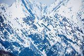 foto of caucus  - Caucasus mountains beautiful winter landscape during daytime in Sochi ski resort Krasnaya polyana - JPG