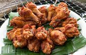 stock photo of southern fried chicken  - Homemade fried chicken drumsticks cooking with original thai style and serve on Weaved pandan - JPG