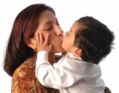 pic of mother-in-love  -  a pretty latin woman holding and kissing her first born young son - JPG