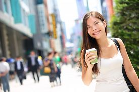 image of commutator  - Tokyo urban woman commuter walking drinking coffee - JPG