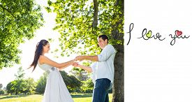 foto of cursive  - i love you against loving young couple holding hands at park - JPG