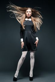 picture of flutter  - Fine art fashion portrait of blond fashion model posing with hair fluttering in the wind - JPG