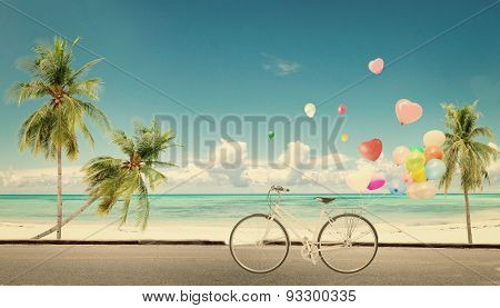 bicycle vintage with heart balloon on beach