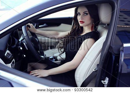 Gorgeous Woman In Elegant Dress Posing In Luxurious Auto