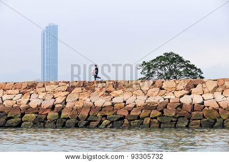 Fisherman And Hong Kong Skyline