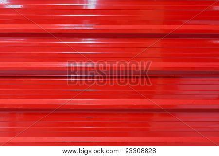 Red aluminium metal texture surface background.
