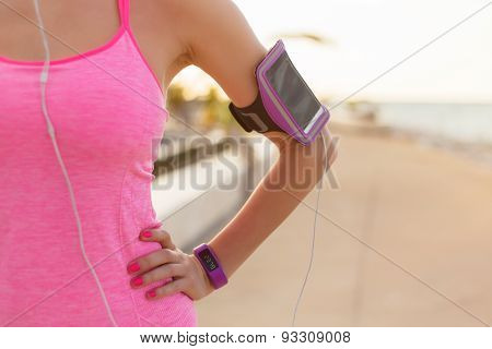 Close-up photo of smartphone holder on woman's arm