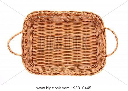 Brown wicker basket isolated on white background top view