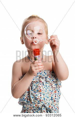 Little Cute Girl Blowing Soap Bubbles Isolated On White Background