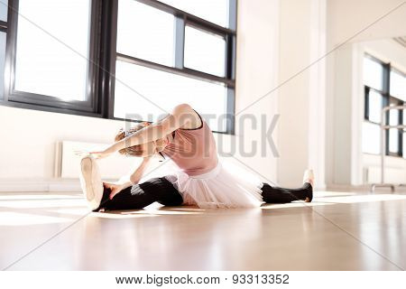 Ballerina Splitting Legs While Reaching Her Toes