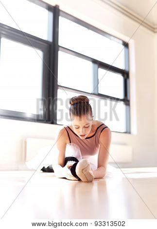 Determined Ballerina Exercising Inside The Studio
