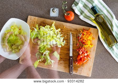 Cook Preparing Fresh Healthy Salad At The Kitchen