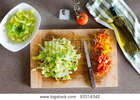 Sliced Veggies Prepared On Cutting Board For Salad