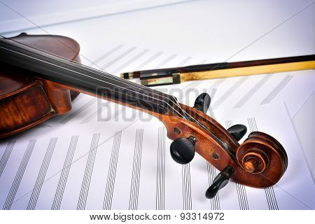 Violin Lying At An Angle On The Notes