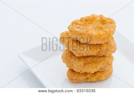 Group of fried chicken nuggets on white dish