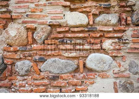Rustic Old Wall Background Made Of Bricks And Stones