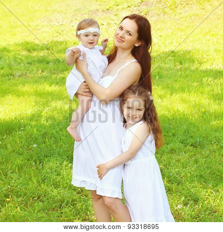 Happy Family, Mother And Two Daughters Childrens Together Having Fun Outdoors On The Nature