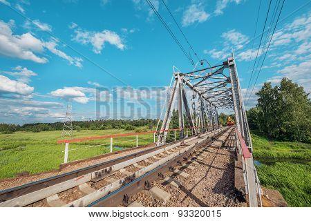Freight Train Appoach To The Railway Bridge.