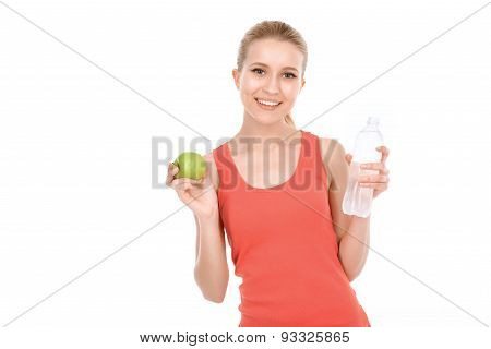 Fit girl with apple and water