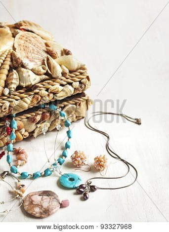 A Collection Of Jewelry In Jewelry Box Decorated With Seashells